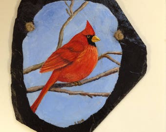 """This red Cardinal on the branch painted on a slate.  Size 7"""" x 8""""     Price 18.00"""
