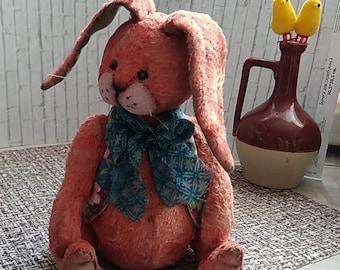 Orange-Kaninchen aus Jahrgang Plüsch 1960.It besteht aus Holz Sägemehl. Es hat 5 Schienen. Die Beine bewegen.