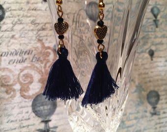 Earrings with blue tassels