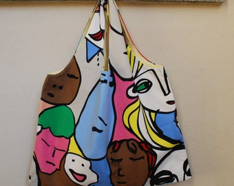Reversible shoulder bag with funny faces