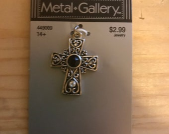 Silver cross with gemstones and heart detailing