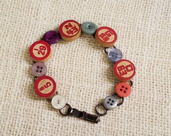 Repurposed vintage jewelry handemade bracelet. Bingo and button bracelet! Red,colorful wood bingo call numbers mixed with antique buttons.