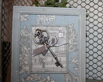 Small wooden frame and its key to happiness!