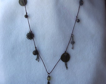 Bronze Charm Necklace on Brown Cord
