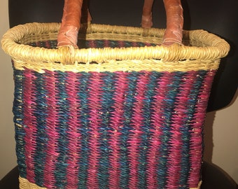 OVAL SHAPED Bolga Basket with leather handles.