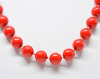 Lovely red tone plastic beaded necklace