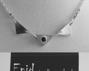 Blue Sapphire tube setting; triangular necklace.