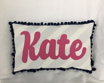 Baby pillow in gray stripes with tiny gold polka dots and name in fuschia pink