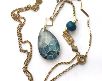 Unique Blue statement necklace handmade with vintage materials.  Crystal pendant customized with geometric pattern.