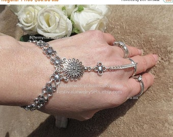 Slave bracelet barefoot sandal combo. Comes with 3 inch extender to turn any silver bracelet rings into barefoot sandals. Adjustable ring