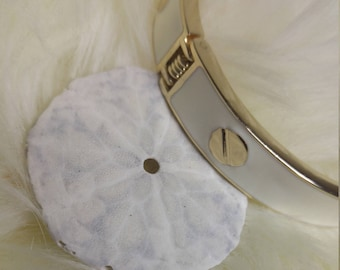 White Epoxy with Metal Disk Detail Goldtone Hinged Bracelet