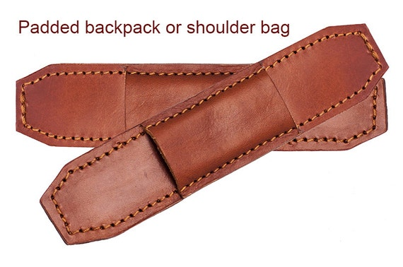 Protective padded leather straps for bag or backpack.