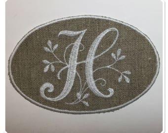 "Monogram Letter ""H"" white embroidery on linen in frame"