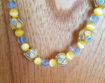 Blue and yellow glass bead necklace and earring set