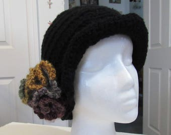 Black beanie cap with a soft flower