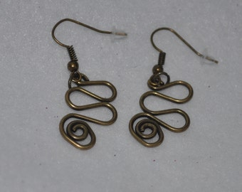 Brass Tone Dangle Earrings with a Swirl Design