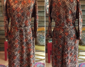 1950s dress in brown and orange with belt
