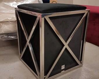 Black stool in metal cage