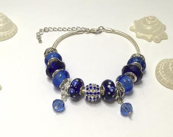Blue charm's bracelet with charms ref 550 beads