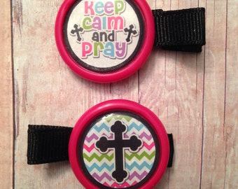 2 Keep calm and pray hair clips with hot pink borders (partially lined alligator clips with no slip grip) -- approx. 2 inches across