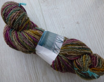 Handspun yarn - blue faced Leicester wool - 119 grams - blend of brown, cerise, green and yellow