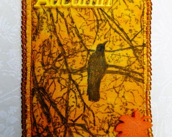 Tiny Art Quilt ATC Seasonal Autumn Image Orange Sky Crow in a Tree with a Plastic leaf