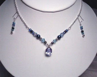 Genuine faceted blue Topaz necklace with sparkle bead accents and earrings