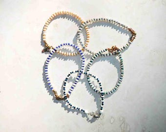 Puka Shell Bracelet Glass Seed Bead Accent and Magnetic Closure With Safety Chain