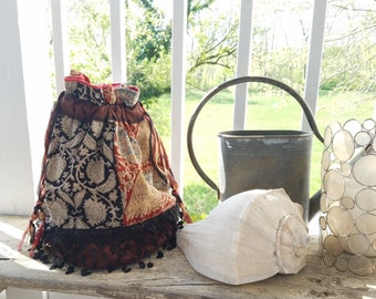 Block printed cotton bucket bag with lace fringe and drawstrings with wood beads