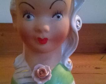 Vintage Enesco head vase of Girl with a rose corsage.
