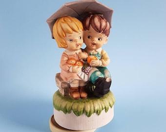 Cute vintage wind up musical ornament   Girl & boy under umbrella   Raindrops keep falling on my head
