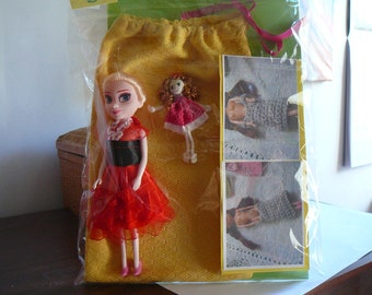 6/small doll and her wardrobe.