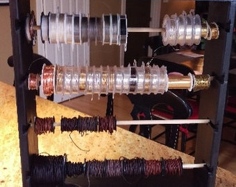 Jewelry wire spool organizer  holds aprox 100 spools brushed black