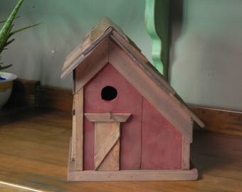 country barn style hand crafted bird house. stained and painted finish