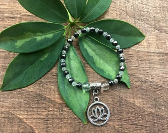 Clear Quartz Mala Beads Bracelet with Lotus Charm - Ideal for the use healing & channeling your inner energy when you feel tired or drained.