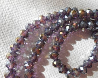 50 pearls multifacets purple shaded with Golden reflections