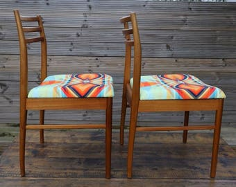 FREE SHIPPING! Pair of vintage Heals teak chairs upholstered in Colour & Form's Bliss Fabric