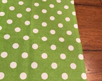 Green and white polka dot table runner