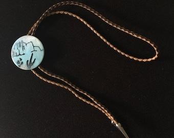 Memorial Moving Sale Enamel on Copper Round Bolo Tie Mesa, AZ Braided Leather Metal Tips