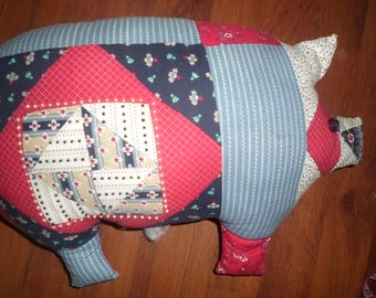 handmade plush fabric pig. patchwork design 1 side red other side. 16 x 11