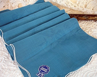 vintage stamped table cloth to embroider . linen look french blue rayon white serged scalloped edge floral motif