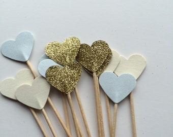 Baby shower cupcake toppers, for cupcakes canapes food picks. In a selection of glittery gold, pearlised baby blue and ivory colours.