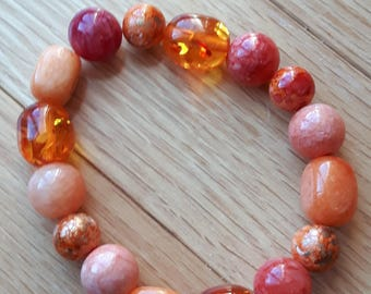 Orange beaded stretch bracelet Multiple shades of orange stretch bracelet Shades of orange beaded bracelet Orange and gold stretch bracelet