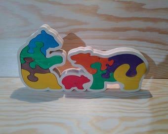 Kids puzzle: bear family on Christmas tree