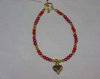 """8"""" Gold Heart Bracelet done in mixed red and gold beads"""