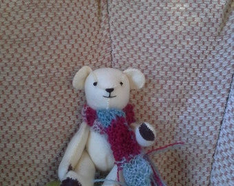 tiny white felt teddy with scarf.