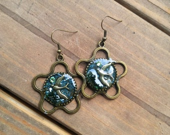 Bird in Flight - hand crafted resin dangle and drop earrings with brass bird charm, dried moss and Swarovski crystals