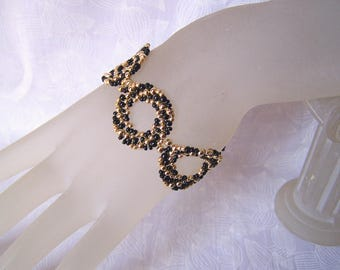 Seed Bead Bracelet Black and Gold Swirls