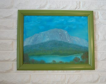 original LANDSCAPE OIL PAINTING by Elliott dated '96 in blues and greens snow covered mountain river fall foliage green frame cloudy skies