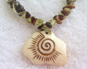 Peridot and tiger eye necklace with bone pendant